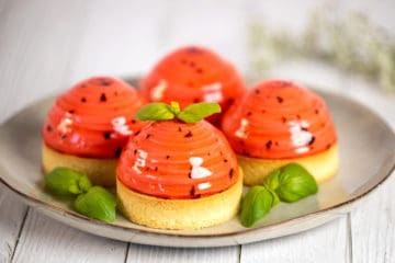Strawberry tartlets with basil glaze